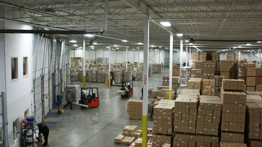 two forklifts in warehouse